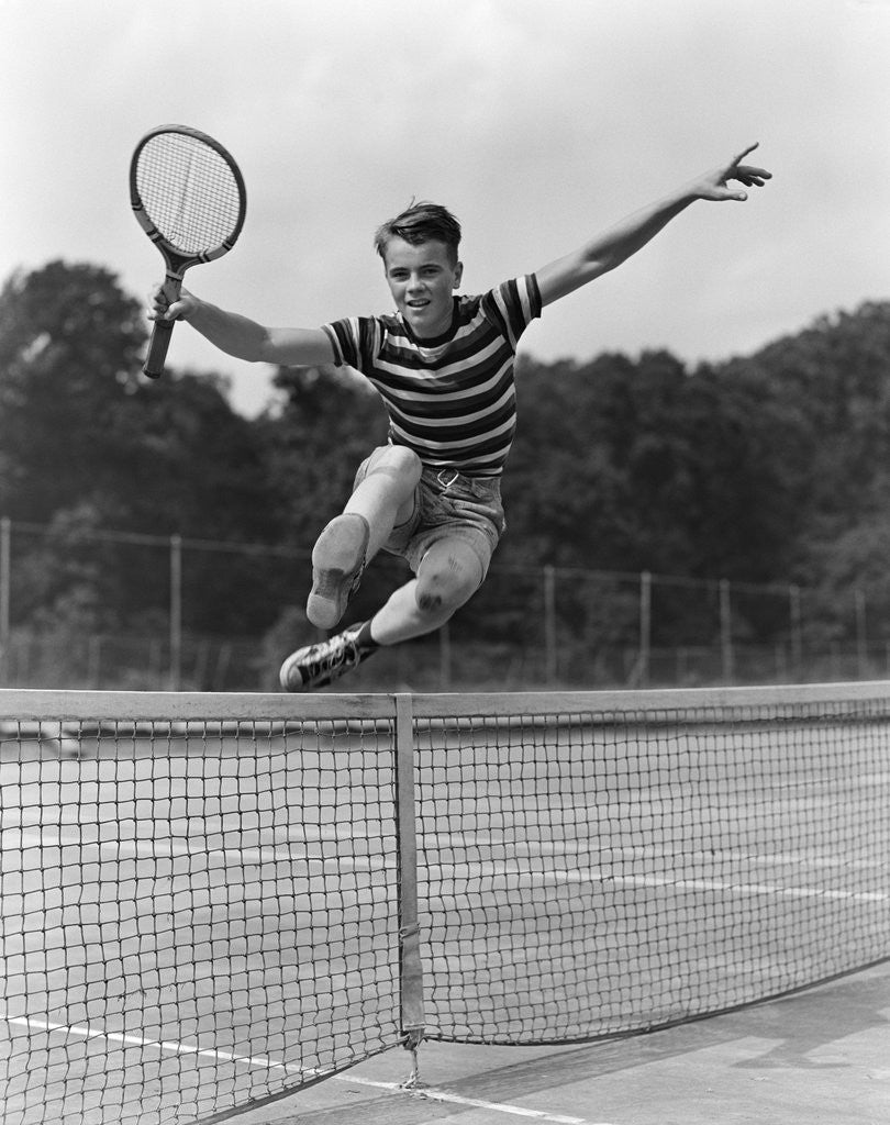 Detail of 1930s Teenage Boy Tennis Player Jumping Net With Racket In Hand by Corbis