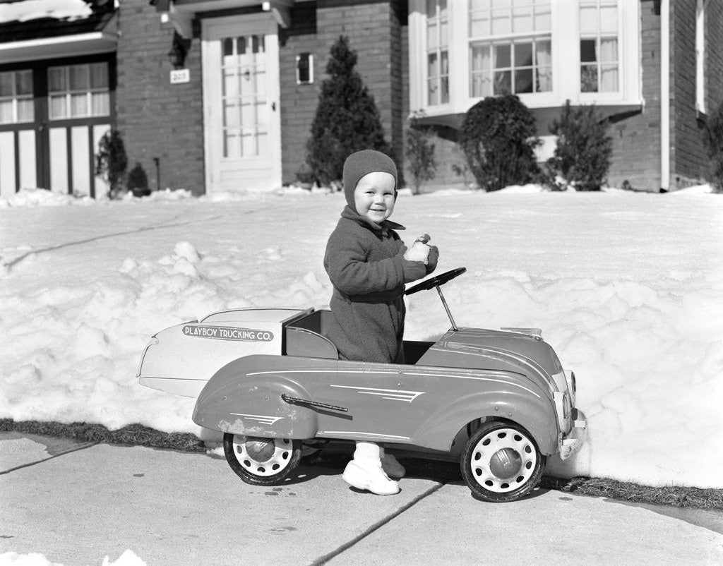 1930s 1940s Little Boy Playing In Toy Car Outside In Snow