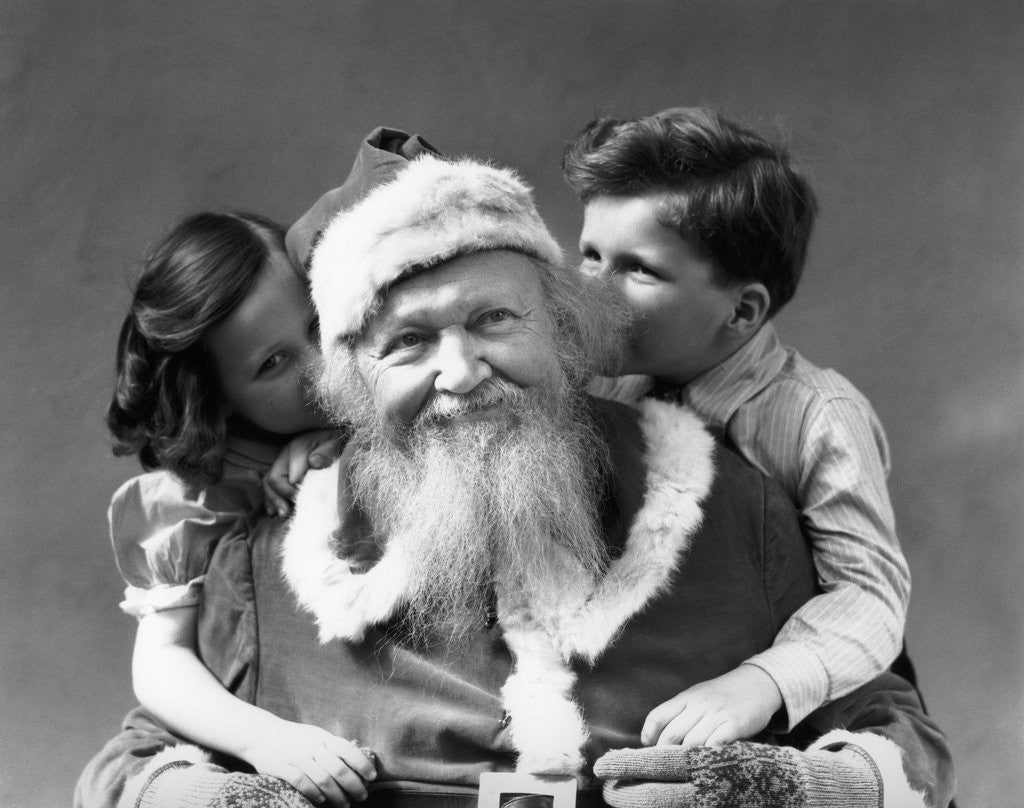 Detail of 1930s Man Santa Claus Posing With Boy And Girl Whispering In His Ears by Corbis