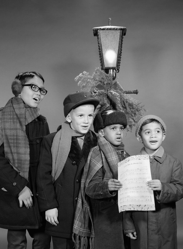 Detail of 1960s Boys Singing Christmas Carol Together Standing By Outdoor Porch Light by Corbis