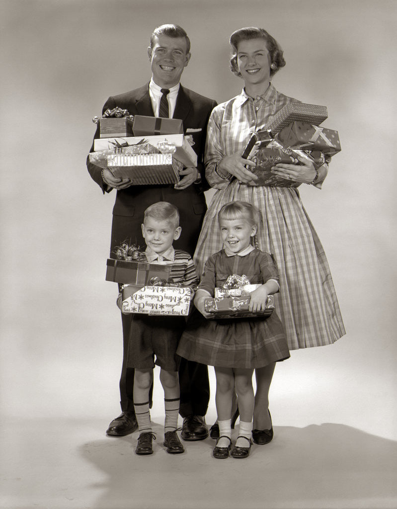 Detail of 1950s 1950s Family Carrying Christmas Gifts Wrapped Presents by Corbis