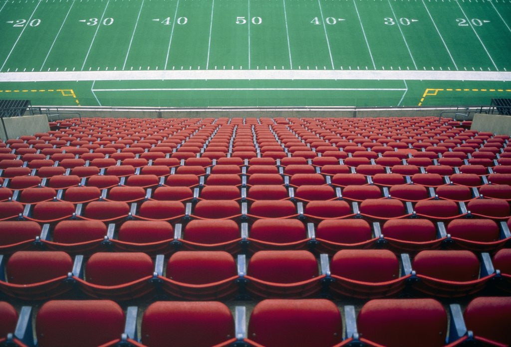 Detail of Empty seats in stadium by Corbis