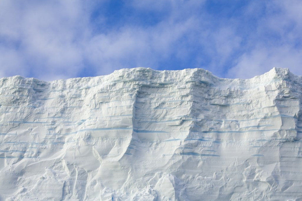 Blue Tabular Iceberg Sculpted by Waves