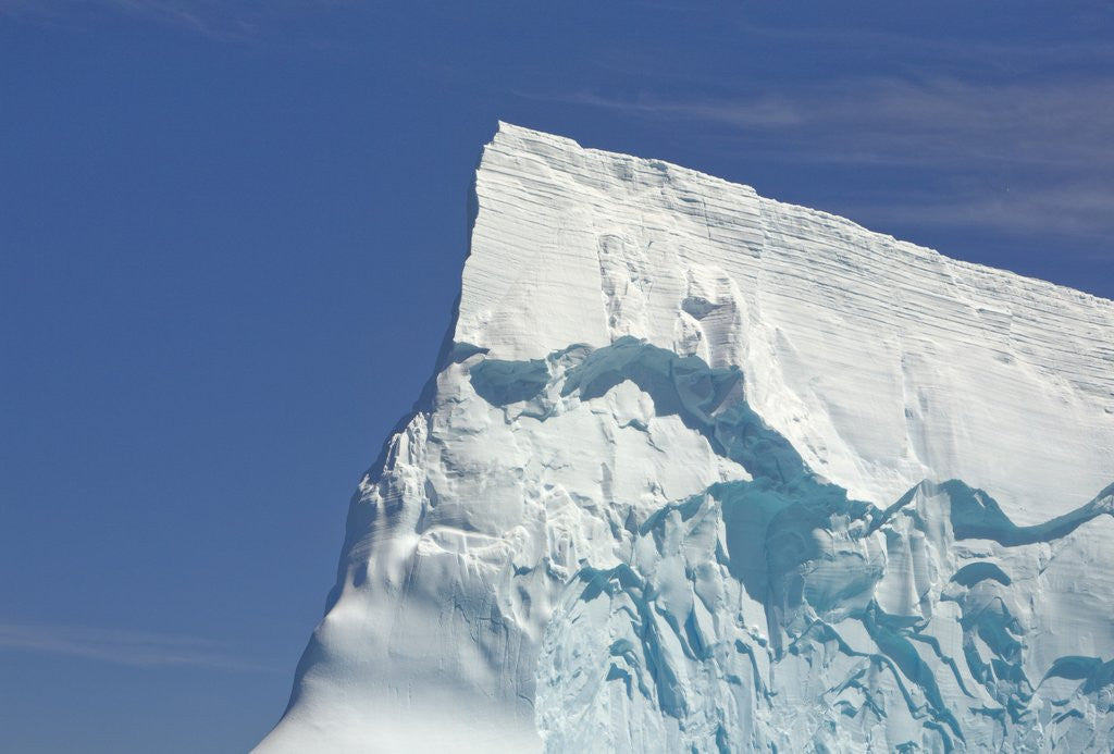 Pointy Blue Iceberg Sculpted by Waves