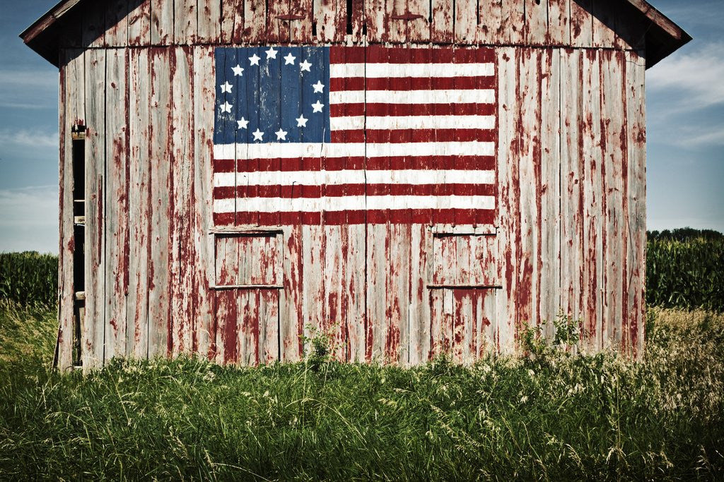 Detail of American flag painted on barn by Corbis