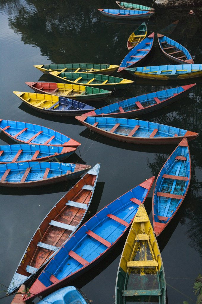 Detail of Canoes floating on water by Corbis