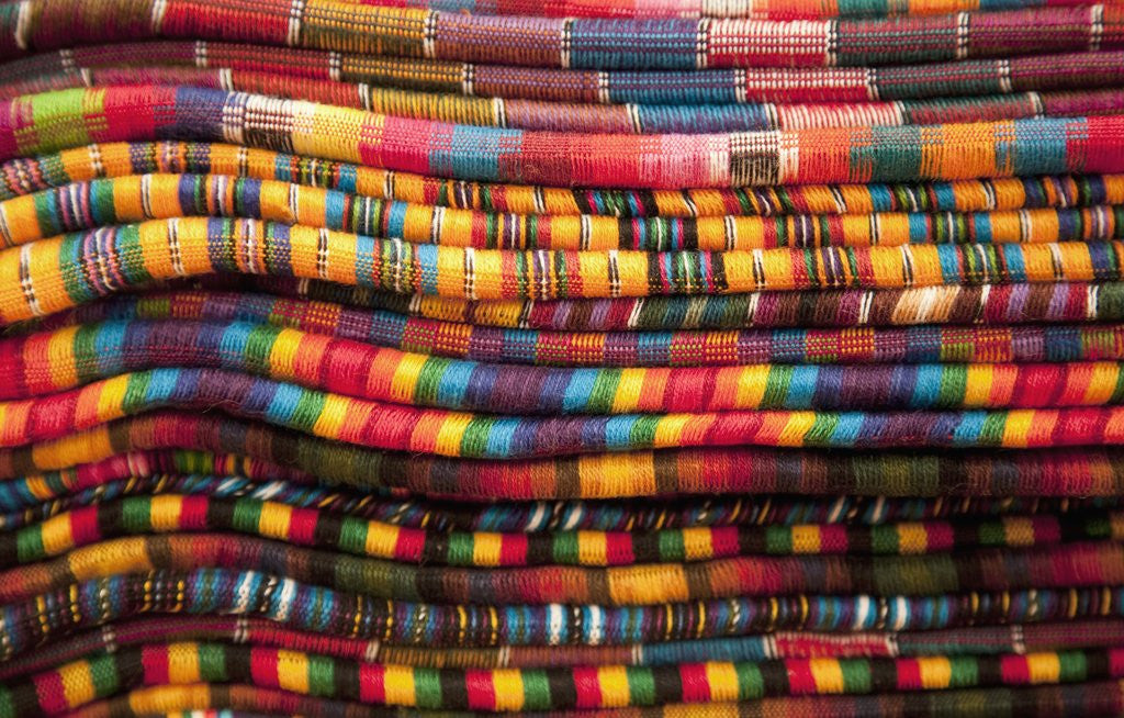 Detail of Textiles for sale in market in San Miguel de Allende by Corbis