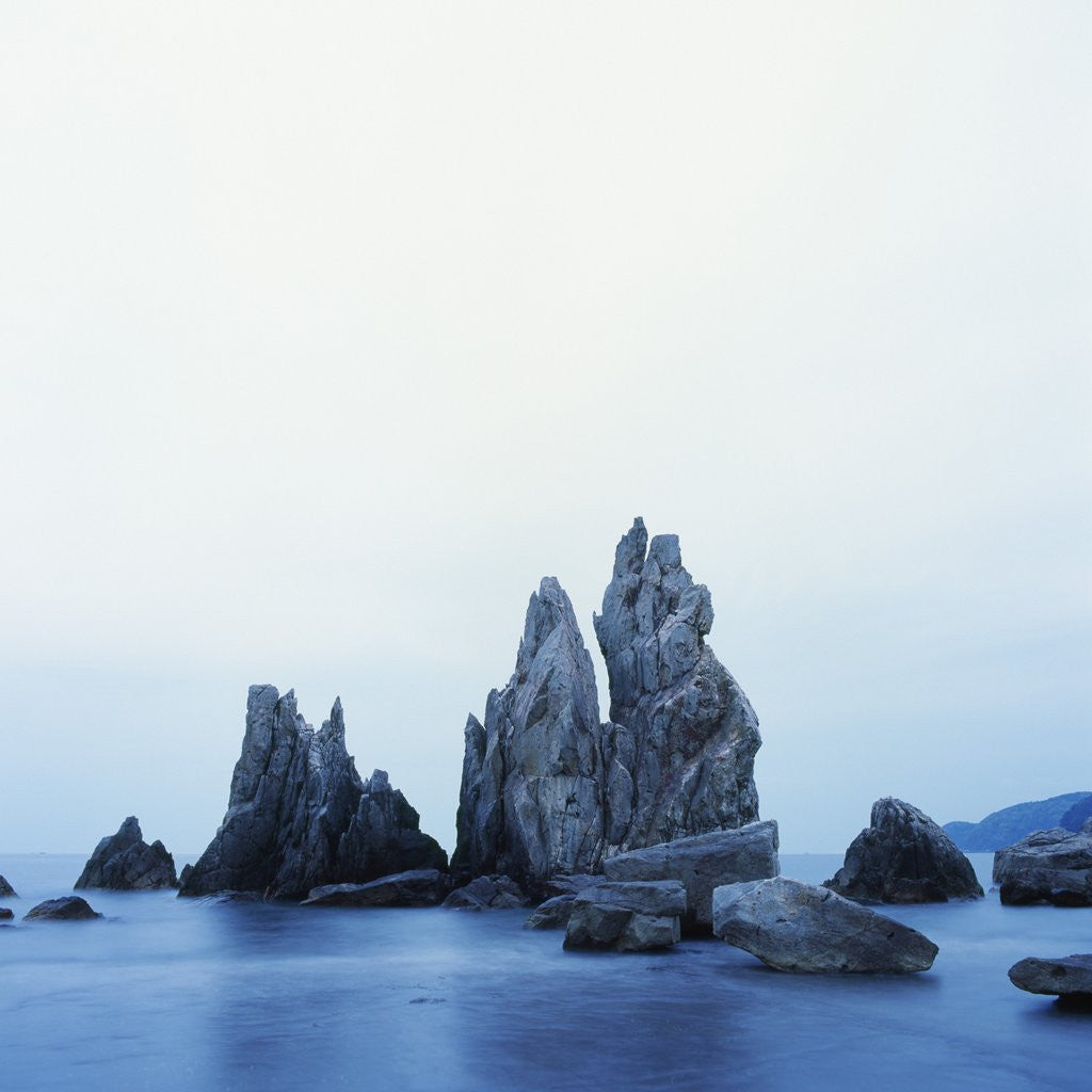 Detail of Dramatically Shaped Sea Stacks in Ocean by Corbis