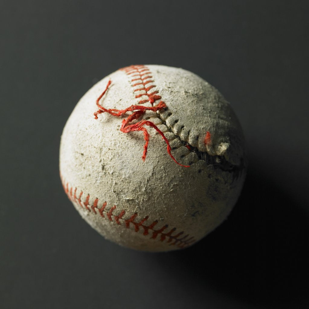 Detail of An old baseball with its stich ripped by Corbis