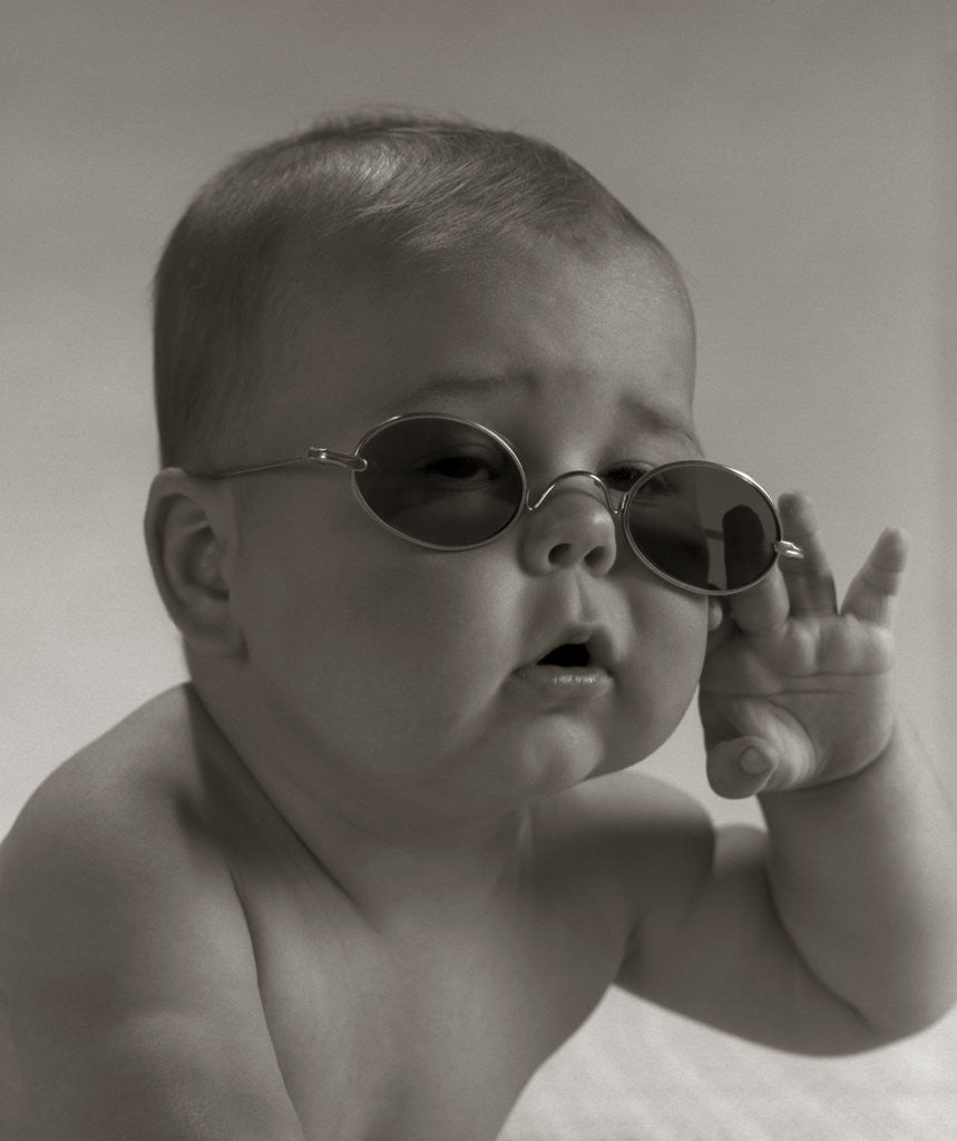 Detail of Baby wearing granny glasses sunglasses by Corbis