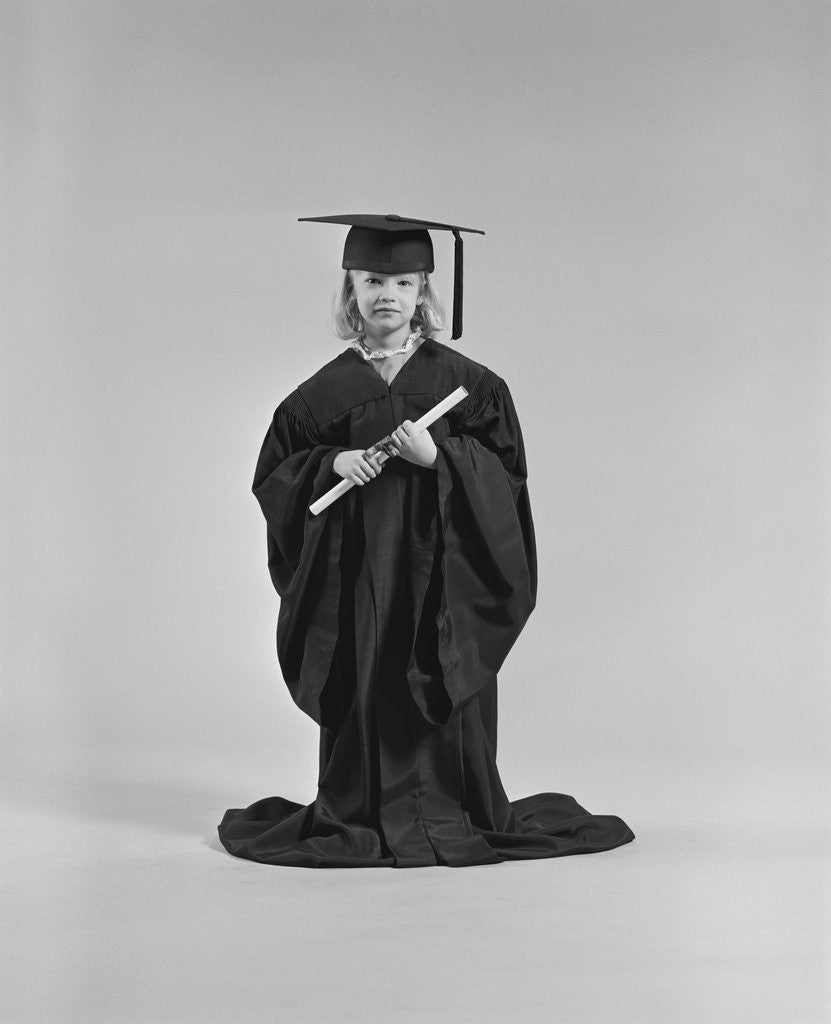 Girl wearing graduation cap gown holding diploma posters & prints by ...