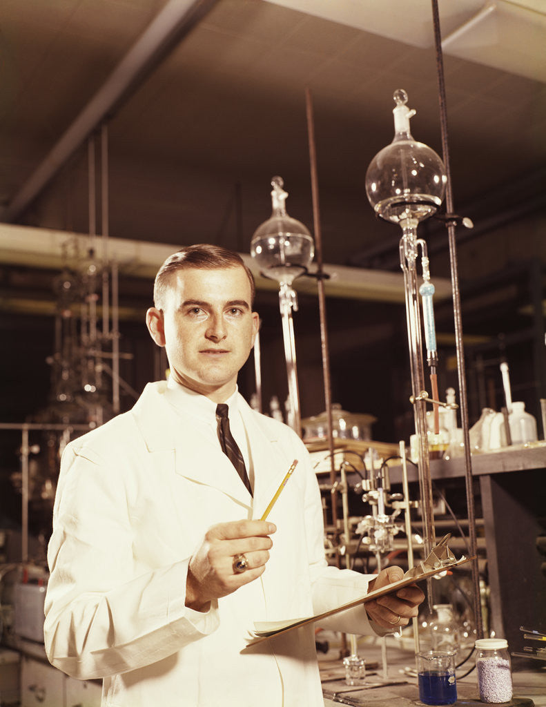 Detail of Scientist conducting a titration experiment by Corbis