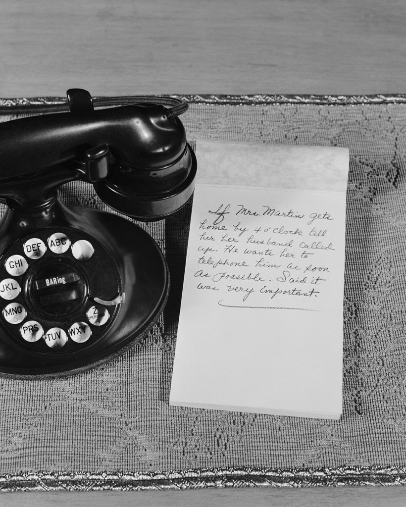 Detail of Rotary telephone note pad with phone message by Corbis