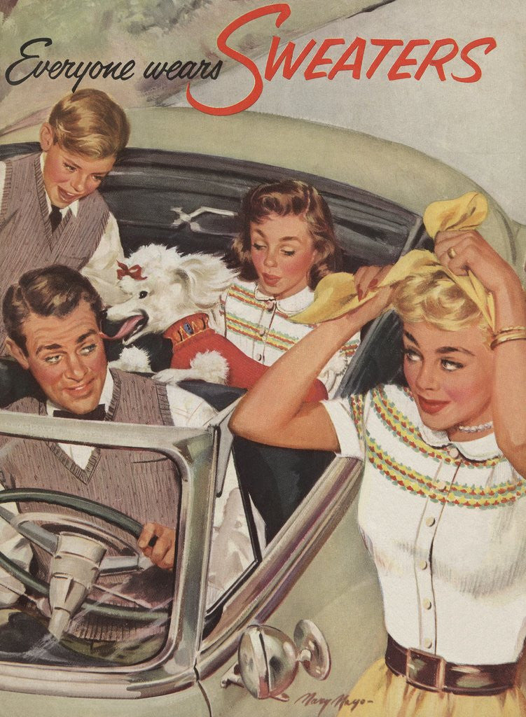 Detail of Family wearing sweaters in convertible by Corbis