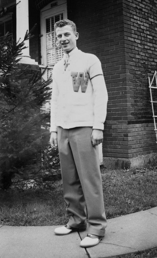 Detail of High school boy wearing his varsity sweater, ca. 1945 by Corbis