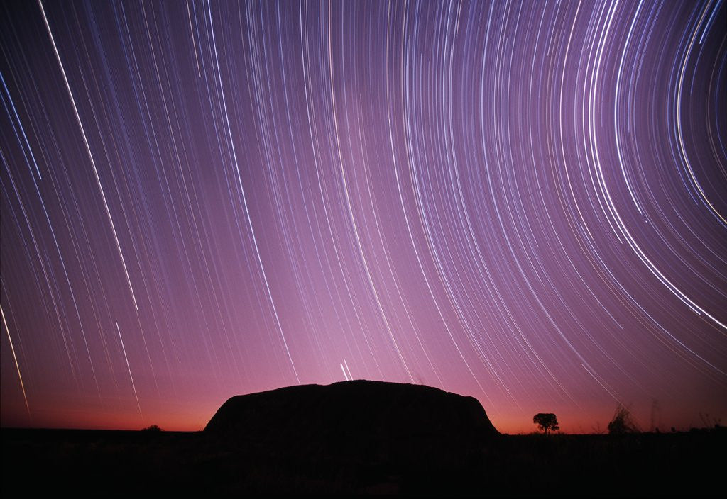 Detail of Ayers Rock and Star Trails, Ulru - Kata Tjuta National Park, Australia by Corbis
