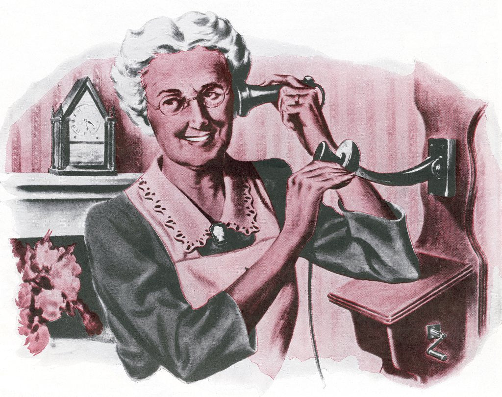 Detail of Grandmother on a crank wall telephone by Corbis