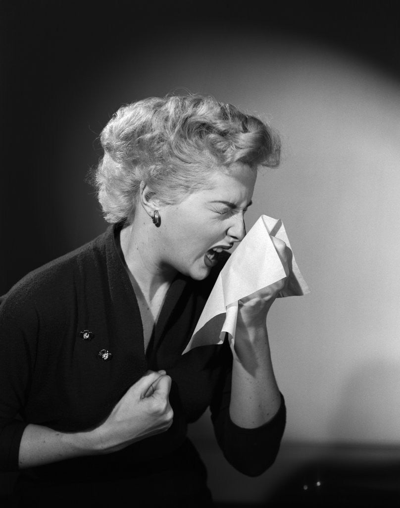 Detail of 1950s woman sneezing cold by Corbis