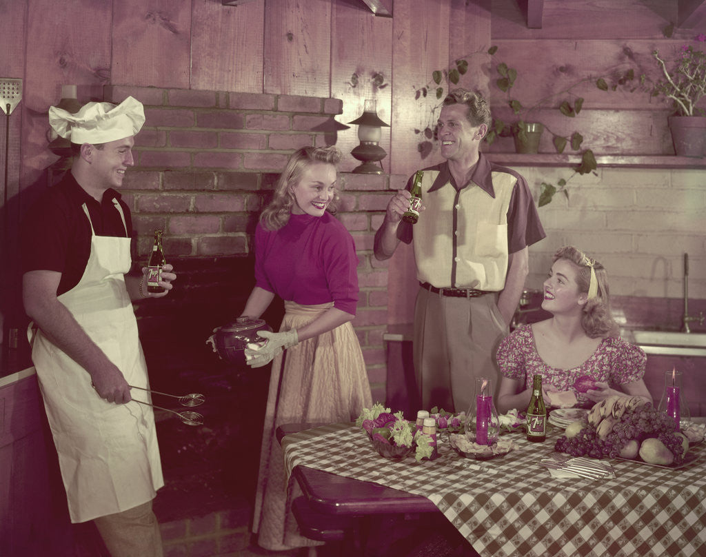 Detail of 1950s 2 couples cooking picnic in rustic kitchen drinking beer by Corbis