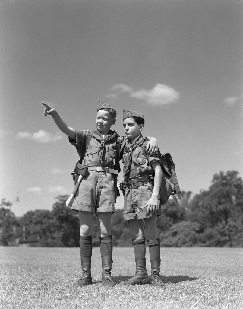 Detail of 1950s two boy scouts one pointing wearing hiking gear uniforms by Corbis