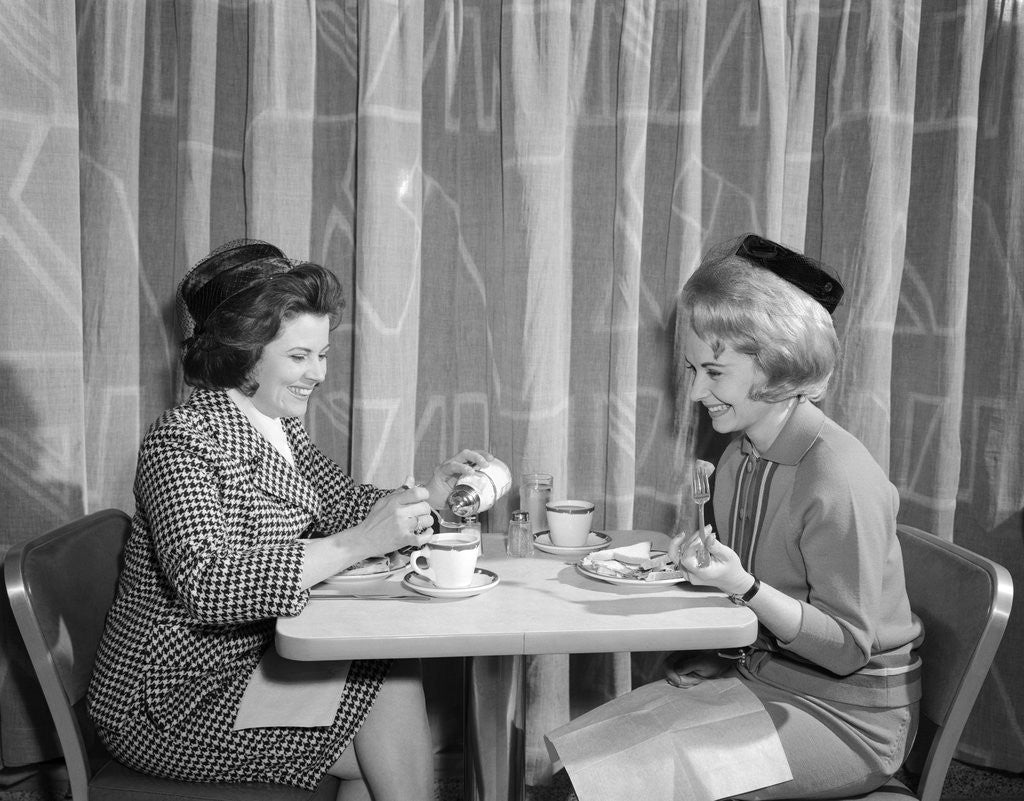 Detail of 1960s two women having lunch in coffee shop restaurant by Corbis