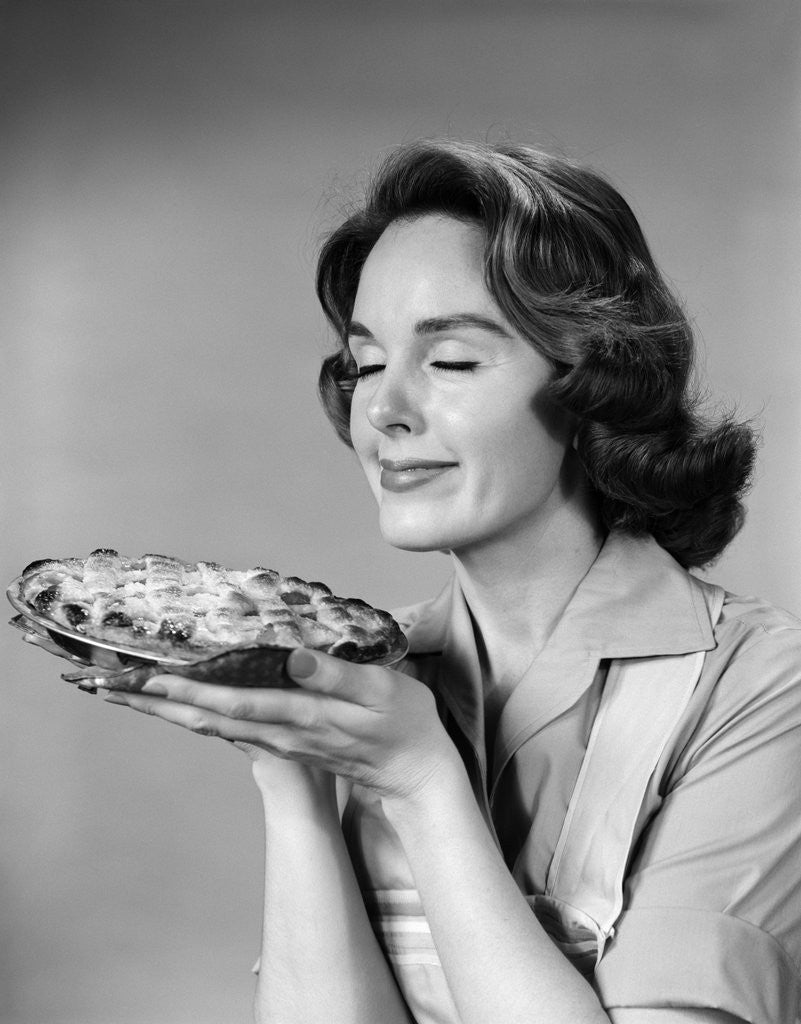 Detail of 1950s 1960s woman smelling aroma of freshly baked pie by Corbis