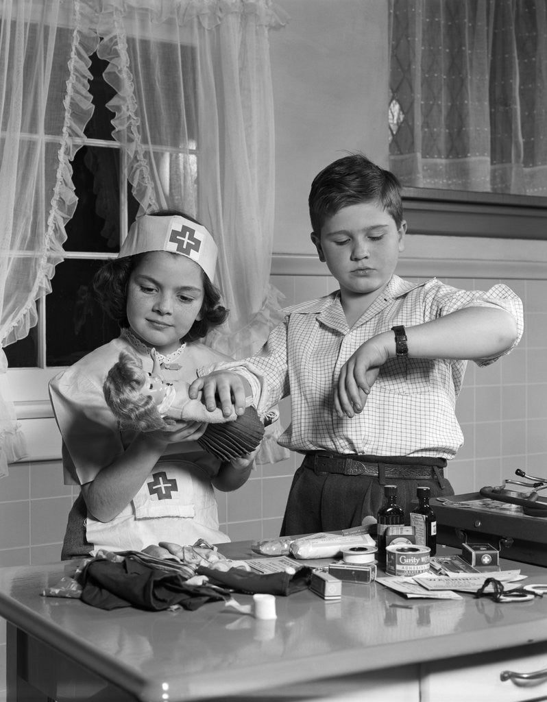 Detail of 1950s two children playing doctor nurse by Corbis