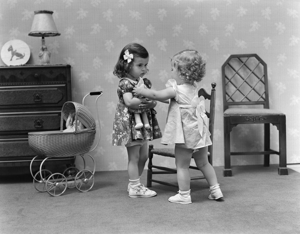 Detail of 1940s two girls playing with dolls by Corbis