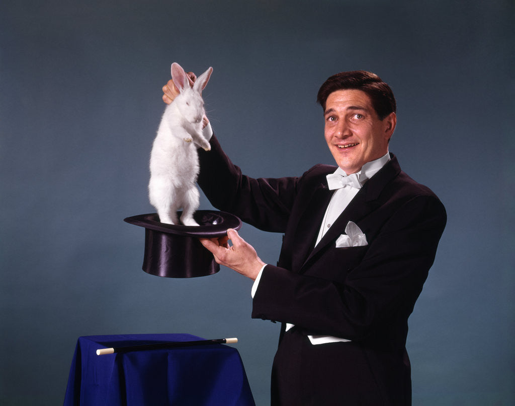 1960s 1970s man magician tuxedo pulling rabbit out of top ...