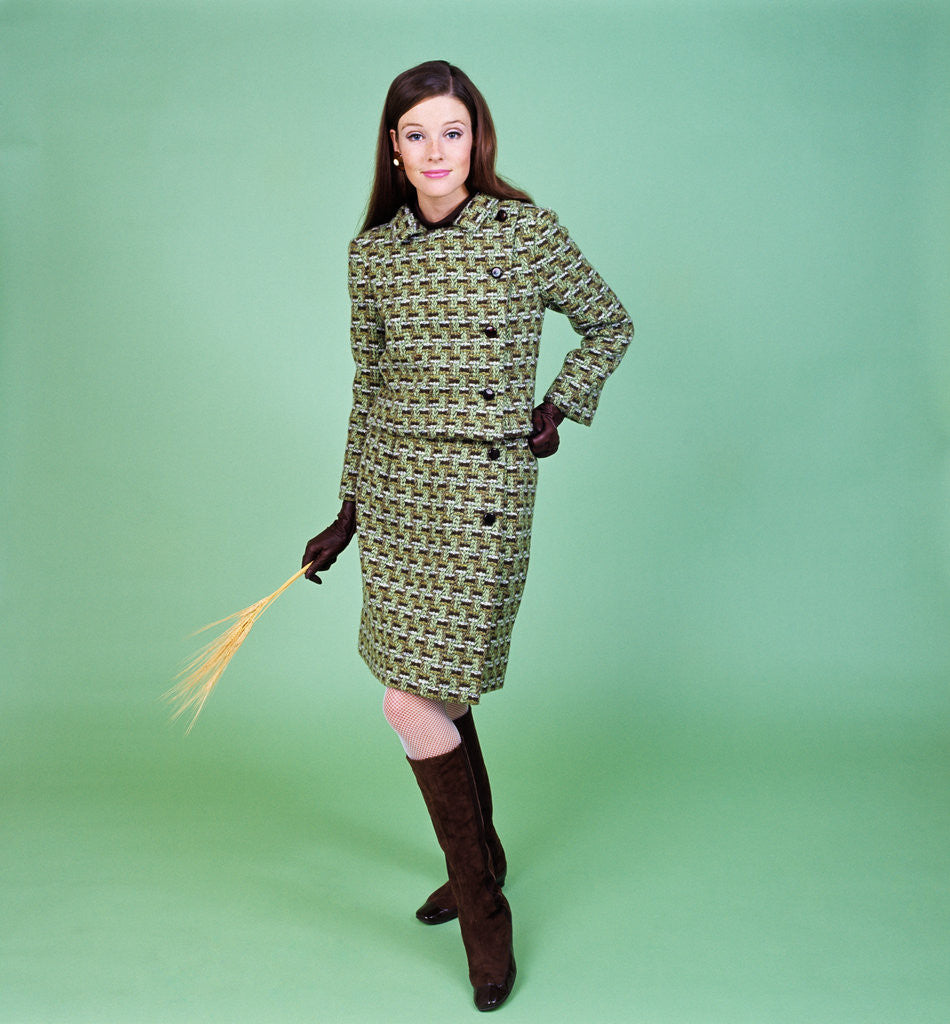 75325e1f95 Detail of 1960s young woman modeling green wool knit two piece suit fishnet  stockings boots full