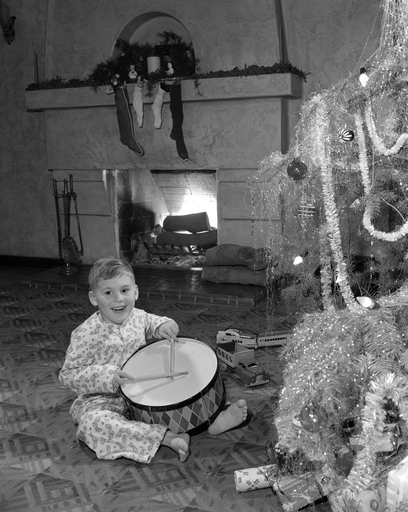 1950 Christmas Toys For Boys : S little boy playing toy drum by christmas tree and