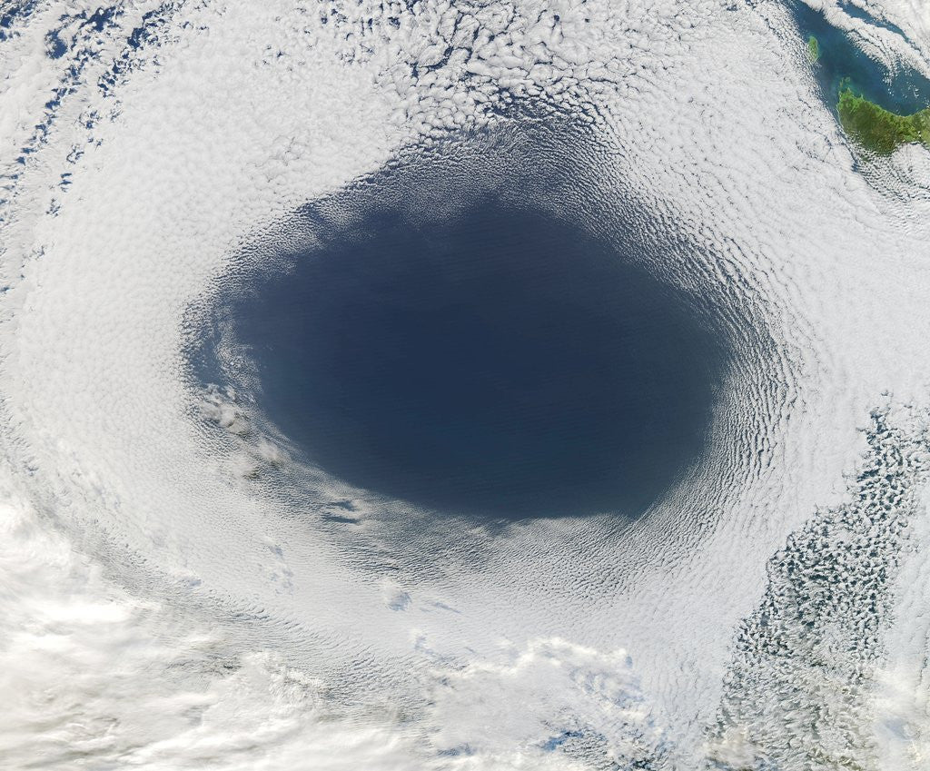 Detail of Cloud hole caused by intense high pressure system by Corbis