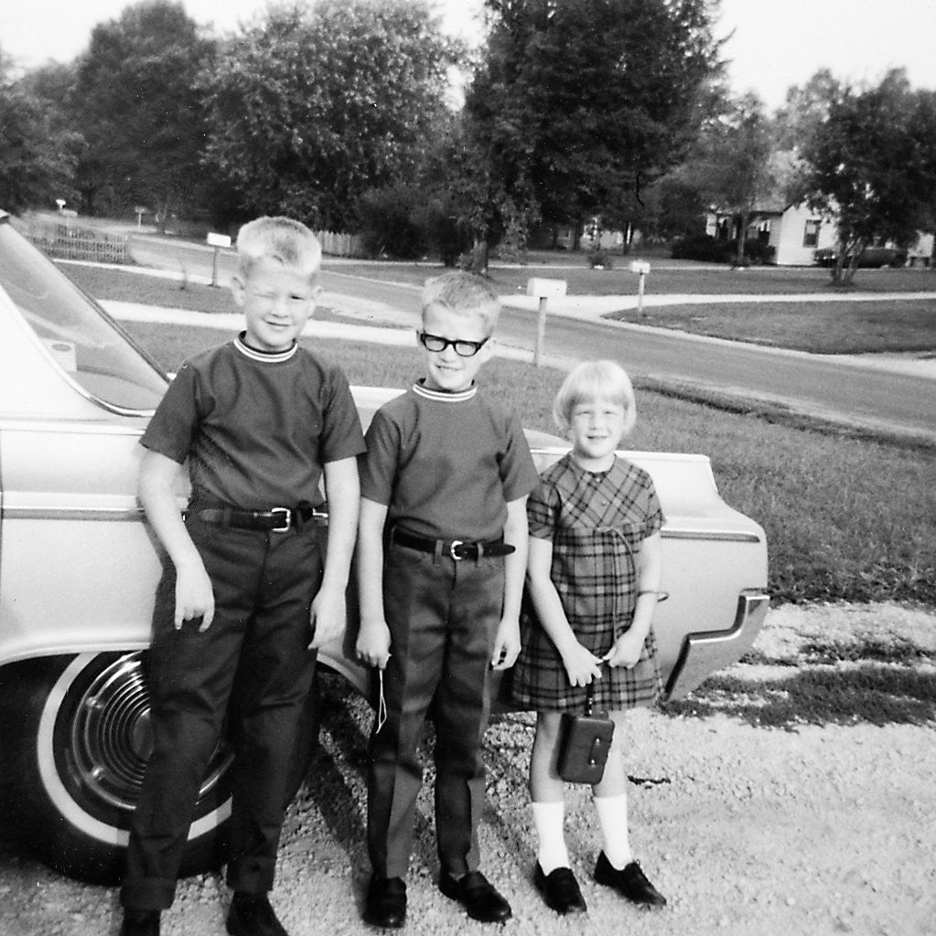 Detail of A lineup of kids by the family car. 1965. by Corbis