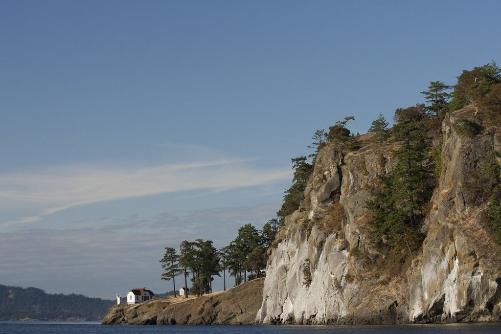 Detail of North America, United States, Washington, lighthouse and cliff in San Juan Islands, by Corbis