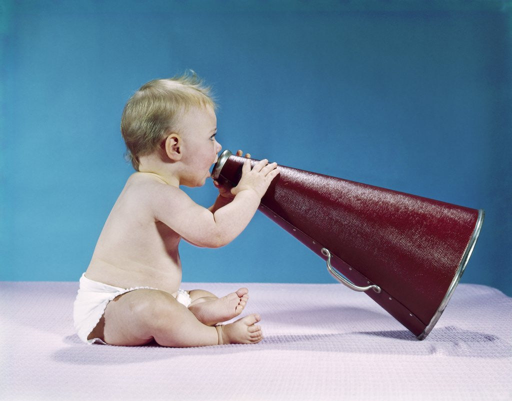 Detail of 1960s Profile Of Seated Baby Shouting Yelling Speaking Into Big Megaphone by Corbis