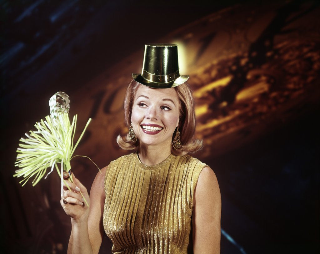 Detail of 1960s Young Blonde Woman Party Hat Noisemaker Horn Smiling New Year Clock Background by Corbis