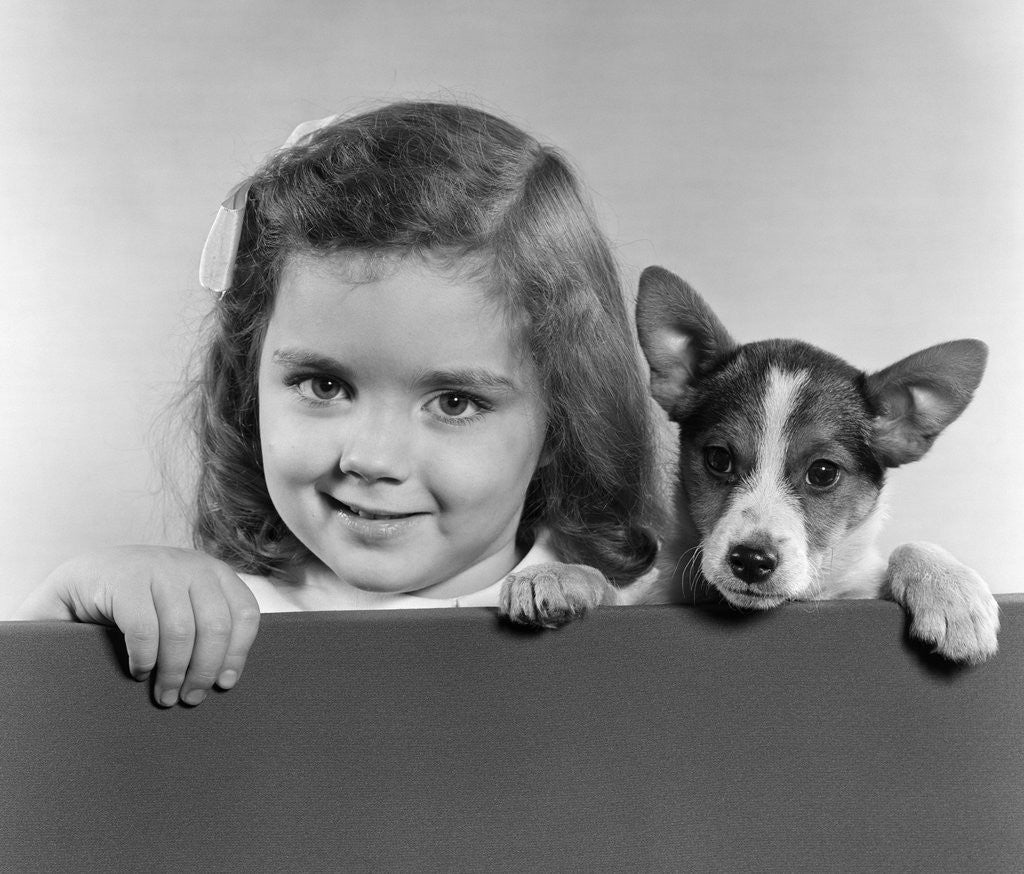 Detail of 1940s 1950s Portrait Of Little Girl With Small Dog Looking At Camera by Corbis