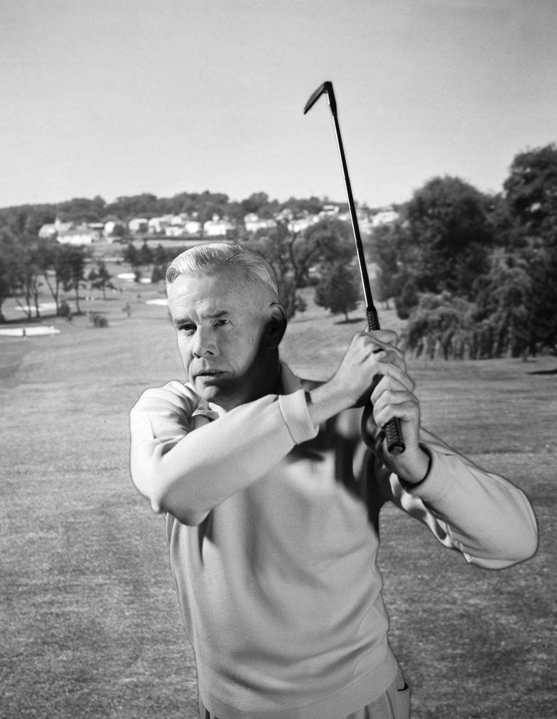 1960s Man Playing Golf Hitting Golf Ball From Fairway With Iron Club by Corbis