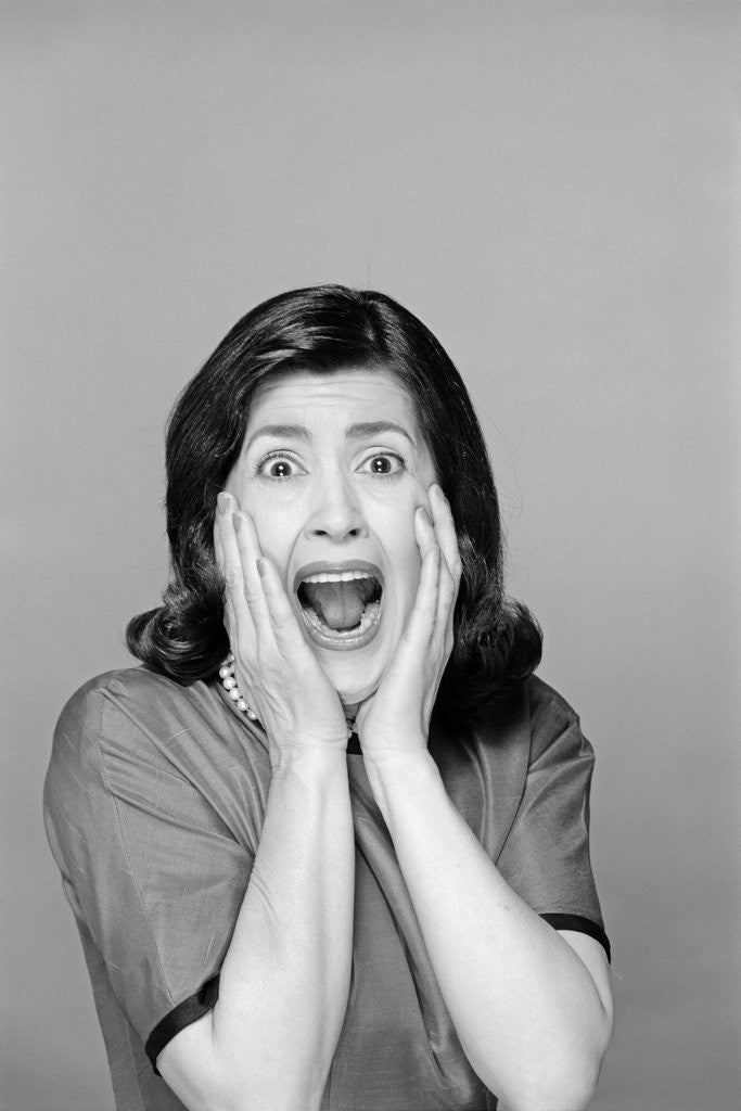 Detail of 1960s Brunette Woman Screaming Mouth Wide Open Hands To Face Facial Expression Fear Scream Surprise Character Funny Face by Corbis