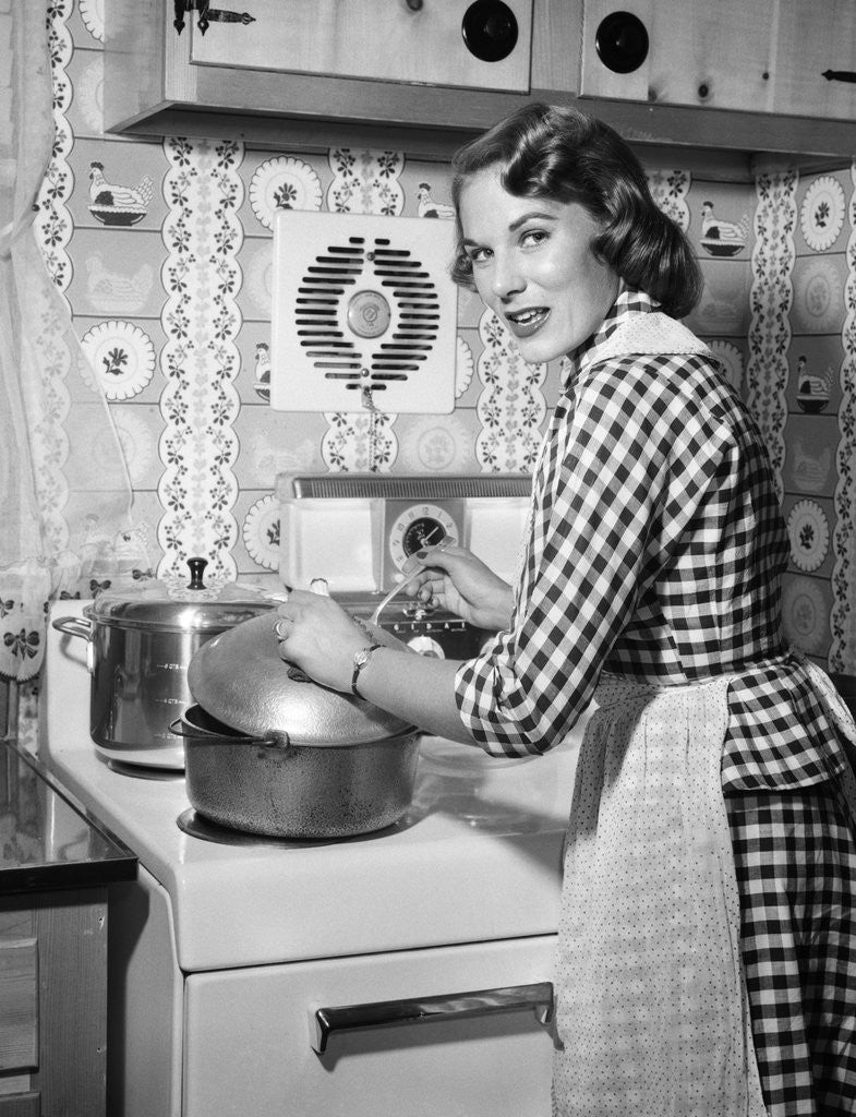 1950s Housewife Wearing Checkered Dress Standing In ...