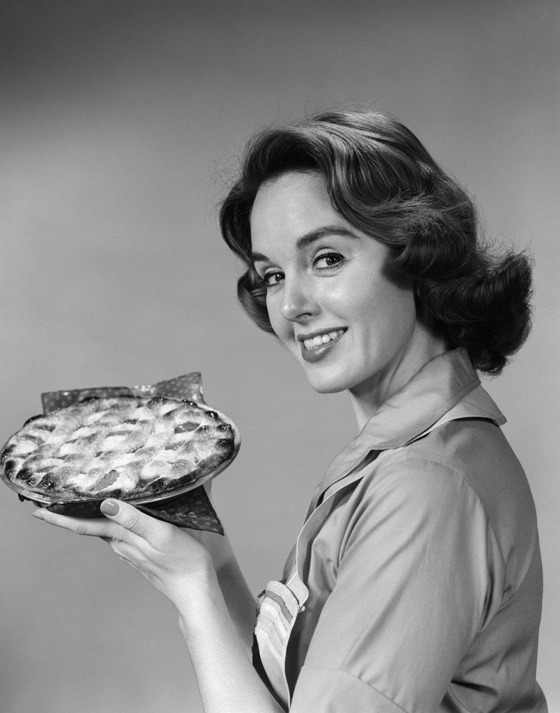 Detail of 1950s 1960s Smiling Woman Holding Freshly Baked Pie Looking At Camera by Corbis