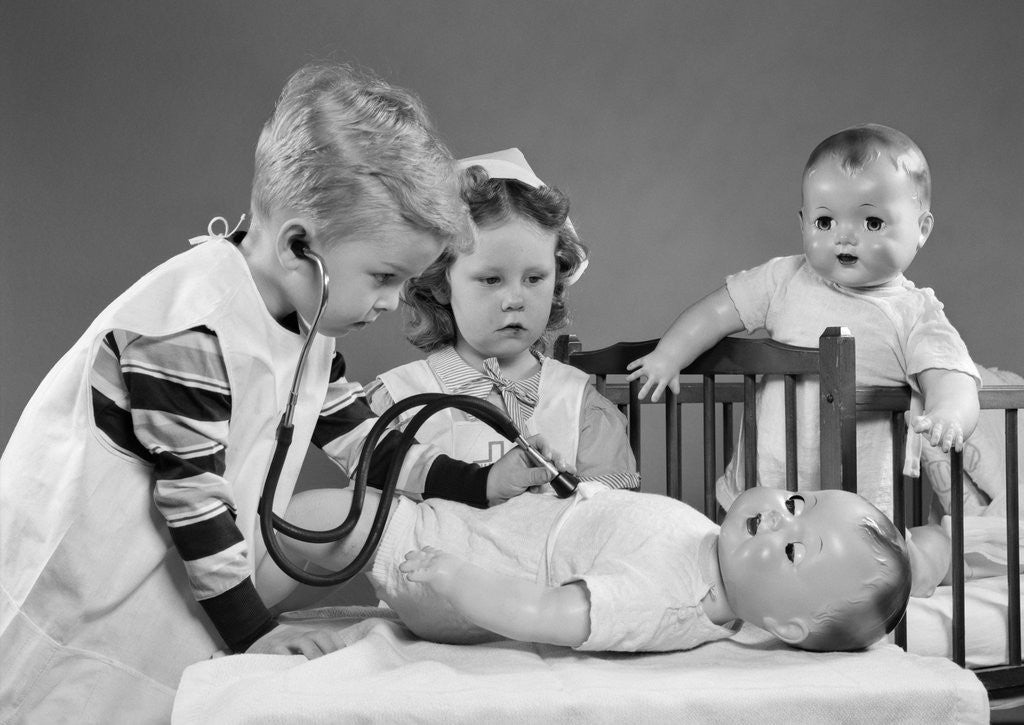 Detail of 1950s Boy And Girl Playing Doctor And Nurse With Stethoscope And Dolls by Corbis