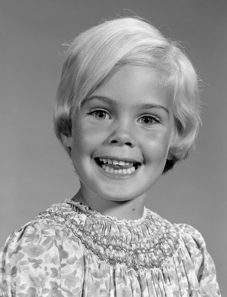Detail of 1960s Portrait Of Smiling Blond Girl Looking At Camera by Corbis