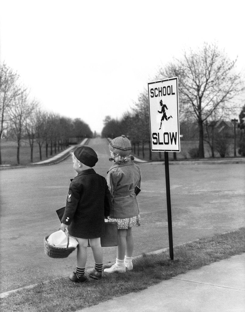 Detail of 1930s 1940s boy and girl waiting to cross the road by Corbis