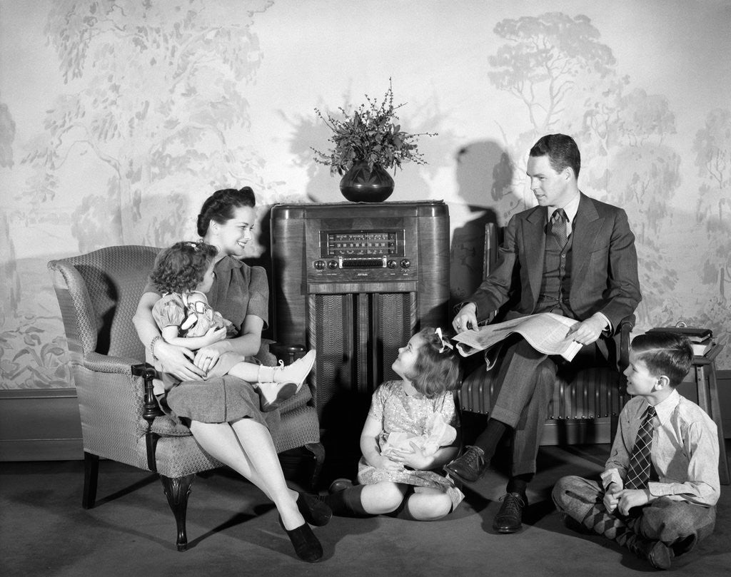 Detail of 1930s 1940s family of five listening to the radio by Corbis