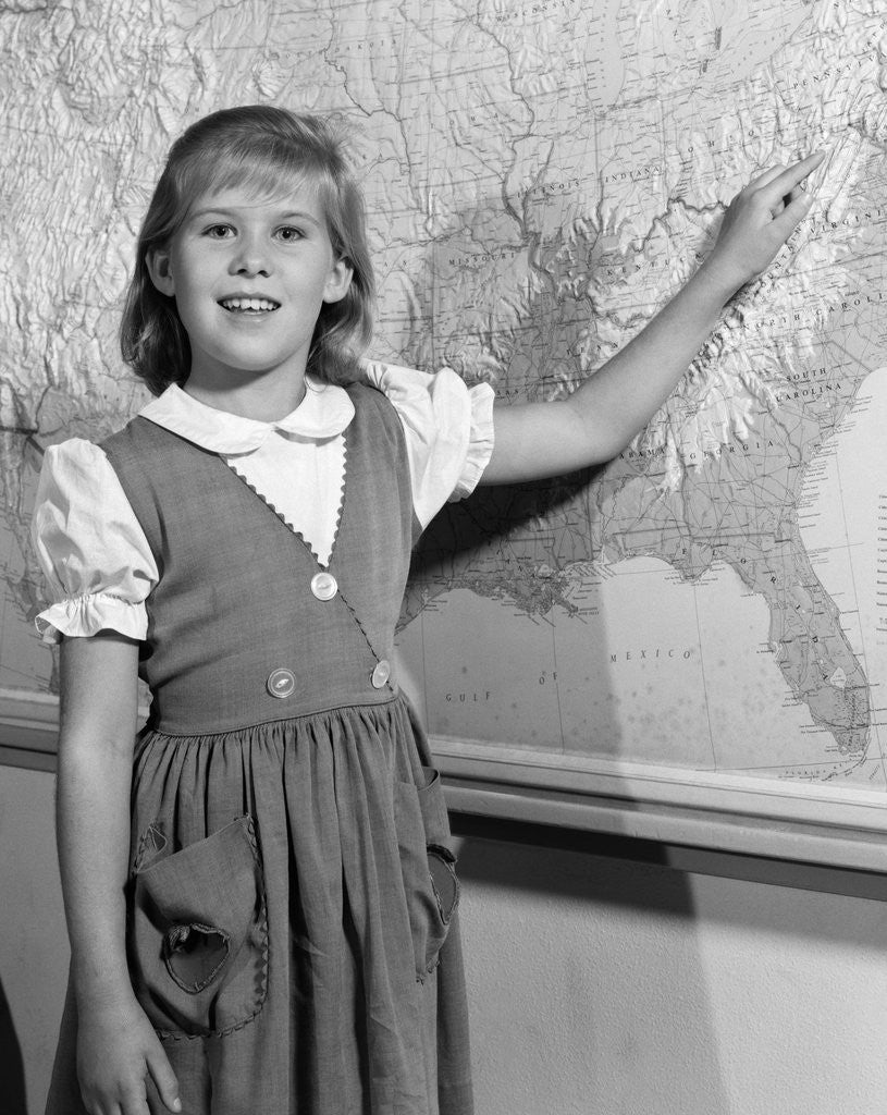 Detail of 1960s school girl pointing to map of the USA by Corbis