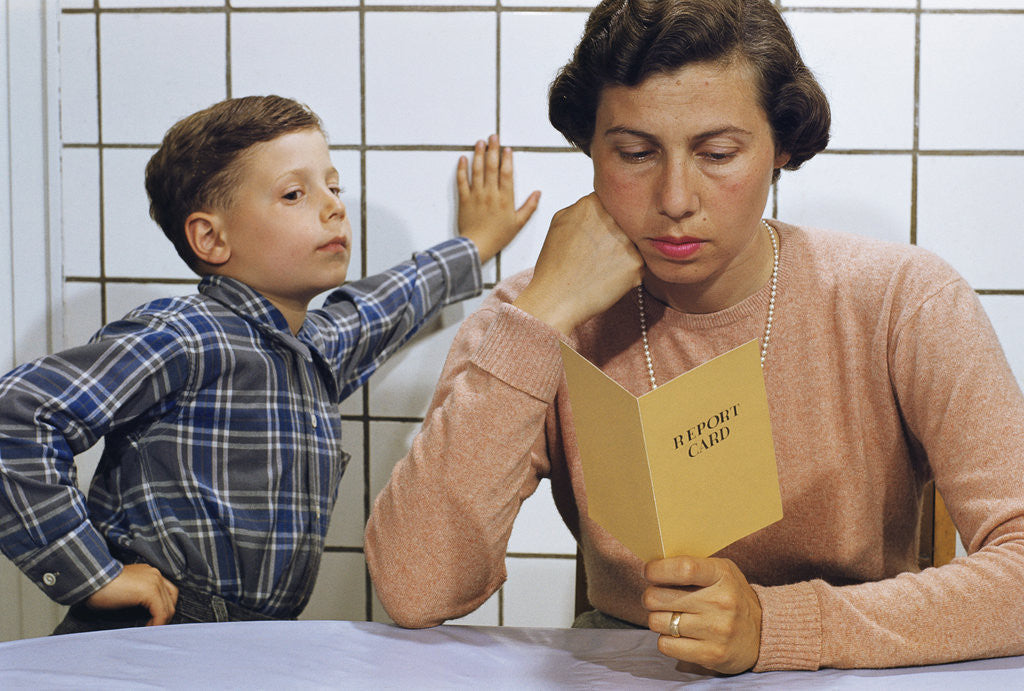 Detail of Disappointed Mother Reading Son's Report Card by Corbis