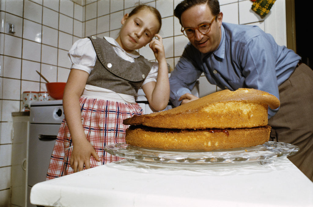 Detail of Father and Daughter Looking at Fallen Cake by Corbis