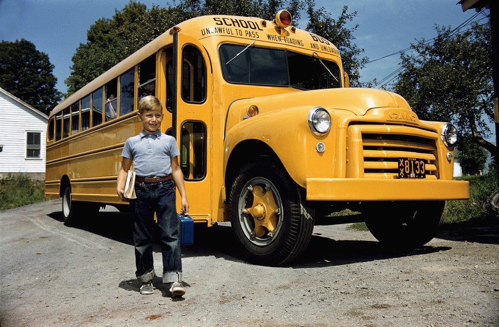 Detail of School Bus Dropping off Child at Home by Corbis