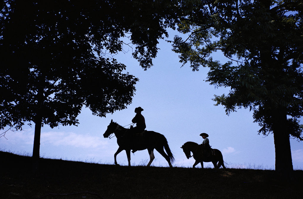 Detail of Father and Son Riding Horses by Corbis